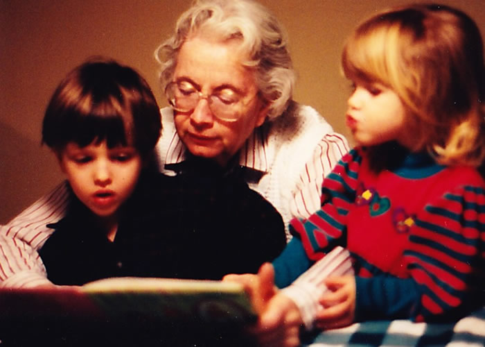 Grandma reading to grandkids - before dementia set in