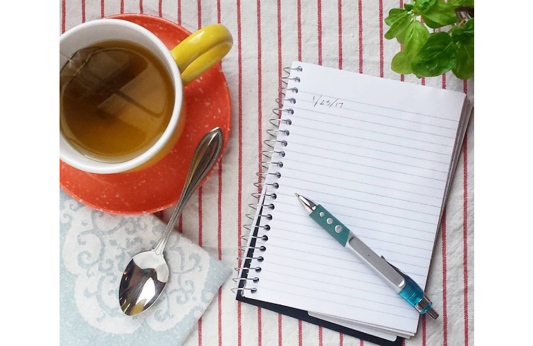 Early in the morning; tea and journal